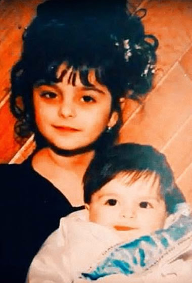 Young Bebe Rexha with her younger brother